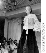 Купить «United States: c. 1969 A young woman on a runway models a lacy see through blouse by Chloe», фото № 26175507, снято 30 апреля 2017 г. (c) age Fotostock / Фотобанк Лори