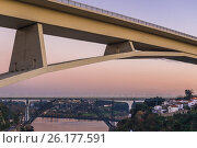 Купить «View on three bridges connecting Porto and Vila Nova de Gaia: Infante D. Henrique Bridge and railway bridges Maria Pia (old) and Saint John, Portugal.», фото № 26177591, снято 11 декабря 2016 г. (c) easy Fotostock / Фотобанк Лори