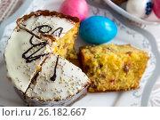 Купить «Cut Easter cake and dyed eggs», фото № 26182667, снято 16 апреля 2017 г. (c) Володина Ольга / Фотобанк Лори