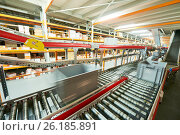 Купить «Automated warehouse. Boxes with spare parts moving on conveyer», фото № 26185891, снято 3 февраля 2017 г. (c) Дмитрий Калиновский / Фотобанк Лори