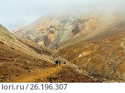 Climbing to active volcano Mutnovsky on Kamchatka. Стоковое фото, фотограф Zoonar/yykkaa / easy Fotostock / Фотобанк Лори