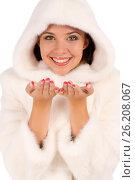 Girl in a white coat with open hands palm smiling, фото № 26208067, снято 20 июля 2012 г. (c) Tatjana Romanova / Фотобанк Лори