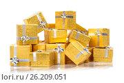 A pile of gold gifts on white, фото № 26209051, снято 18 августа 2012 г. (c) Tatjana Romanova / Фотобанк Лори