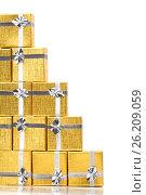 Close up of a pile of gold gifts on white, фото № 26209059, снято 18 августа 2012 г. (c) Tatjana Romanova / Фотобанк Лори