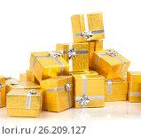 A pile of gold gifts on white, фото № 26209127, снято 18 августа 2012 г. (c) Tatjana Romanova / Фотобанк Лори