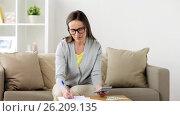 Купить «woman with money, papers and calculator at home», видеоролик № 26209135, снято 22 августа 2019 г. (c) Syda Productions / Фотобанк Лори