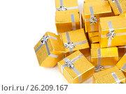 Close up of a pile of gold gifts on white, фото № 26209167, снято 18 августа 2012 г. (c) Tatjana Romanova / Фотобанк Лори