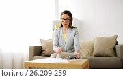 Купить «woman with money, papers and calculator at home», видеоролик № 26209259, снято 22 августа 2019 г. (c) Syda Productions / Фотобанк Лори