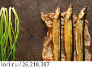 Fish saury smoked in the paper and concrete background. Стоковое фото, фотограф Наталья Майорова / Фотобанк Лори