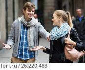 Купить «Nice-looking male student chasing pleased girl on outdoor date», фото № 26220483, снято 18 октября 2018 г. (c) Яков Филимонов / Фотобанк Лори