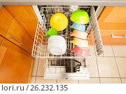 Купить «Opened dishwasher with crockery in it's rack», фото № 26232135, снято 19 марта 2017 г. (c) Сергей Новиков / Фотобанк Лори