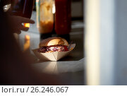 Купить «hamburger in disposable paper plate on table», фото № 26246067, снято 3 октября 2016 г. (c) Syda Productions / Фотобанк Лори