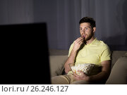Купить «man watching tv and eating popcorn at night», фото № 26246127, снято 26 ноября 2016 г. (c) Syda Productions / Фотобанк Лори