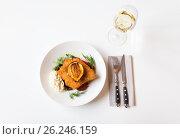 Купить «fish salad and wine glass on restaurant table», фото № 26246159, снято 16 января 2017 г. (c) Syda Productions / Фотобанк Лори