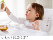 Купить «baby drinking from spout cup in highchair at home», фото № 26246211, снято 24 января 2017 г. (c) Syda Productions / Фотобанк Лори