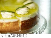 Купить «close up of lime cake on stand», фото № 26246411, снято 17 февраля 2017 г. (c) Syda Productions / Фотобанк Лори