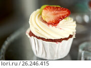 Купить «close up of cupcake with cream and strawberry», фото № 26246415, снято 17 февраля 2017 г. (c) Syda Productions / Фотобанк Лори