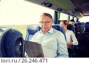 happy senior man reading newspaper in travel bus, фото № 26246471, снято 21 октября 2015 г. (c) Syda Productions / Фотобанк Лори