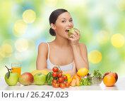 Купить «woman with fruits and vegetables eating apple», фото № 26247023, снято 12 января 2013 г. (c) Syda Productions / Фотобанк Лори