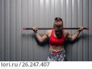 Купить «Fitness woman posing with barbell on shoulders», фото № 26247407, снято 2 апреля 2017 г. (c) Pavel Biryukov / Фотобанк Лори