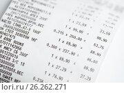 Купить «Магазинный, кассовый чек крупным планом», эксклюзивное фото № 26262271, снято 9 мая 2017 г. (c) Игорь Низов / Фотобанк Лори