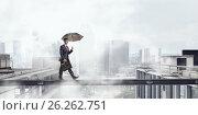 Купить «Fearless businessman overcoming difficulty. Mixed media», фото № 26262751, снято 24 мая 2015 г. (c) Sergey Nivens / Фотобанк Лори