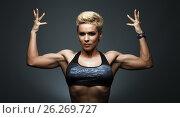 Купить «A very fit woman posing her muscular body», фото № 26269727, снято 22 марта 2017 г. (c) Restyler Viacheslav / Фотобанк Лори