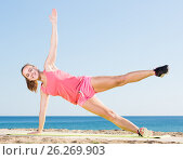 Купить «active young woman exercising on exercise mat outdoor», фото № 26269903, снято 4 июня 2020 г. (c) Яков Филимонов / Фотобанк Лори