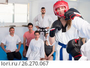 Instructor and trainee are sparring in pair to use taekwondo technique, фото № 26270067, снято 8 апреля 2017 г. (c) Яков Филимонов / Фотобанк Лори