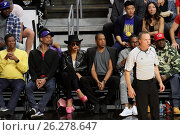 Купить «Celebrities at the Los Angeles Clippers game. The Golden State Warriors defeated the Los Angeles Clippers by the final score of 115-112 at Staples Center...», фото № 26278647, снято 20 февраля 2016 г. (c) age Fotostock / Фотобанк Лори