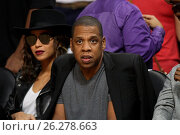 Купить «Celebrities at the Los Angeles Clippers game. The Golden State Warriors defeated the Los Angeles Clippers by the final score of 115-112 at Staples Center...», фото № 26278663, снято 20 февраля 2016 г. (c) age Fotostock / Фотобанк Лори