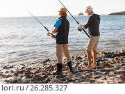 Купить «Senior man fishing with his grandson», фото № 26285327, снято 15 апреля 2015 г. (c) Sergey Nivens / Фотобанк Лори