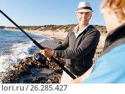 Купить «Senior man fishing with his grandson», фото № 26285427, снято 15 апреля 2015 г. (c) Sergey Nivens / Фотобанк Лори