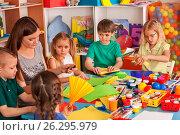 Купить «School children with scissors in kids hands cutting paper .», фото № 26295979, снято 25 марта 2017 г. (c) Gennadiy Poznyakov / Фотобанк Лори