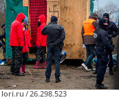 Купить «Riot police, bulldozers, activists and refugees on the fourth day of the evictions and demolition of the Calais Jungle. Featuring: View Where: Calais, United Kingdom When: 03 Mar 2016 Credit: WENN.com», фото № 26298523, снято 3 марта 2016 г. (c) age Fotostock / Фотобанк Лори