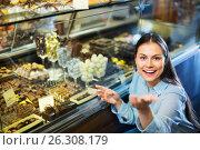 Купить «Smiling pleasant charming girl choosing delicious ganaches», фото № 26308179, снято 31 марта 2020 г. (c) Яков Филимонов / Фотобанк Лори
