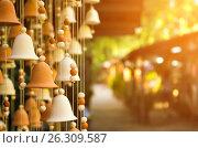 Купить «Hand made wind chimes hanging on a string», фото № 26309587, снято 10 ноября 2016 г. (c) Юрий Губин / Фотобанк Лори