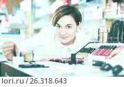 Купить «Customer browsing rows of cosmetic products», фото № 26318643, снято 31 января 2017 г. (c) Яков Филимонов / Фотобанк Лори