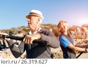 Купить «Senior man fishing with his grandson», фото № 26319627, снято 15 апреля 2015 г. (c) Sergey Nivens / Фотобанк Лори