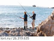 Купить «Senior man fishing with his grandson», фото № 26319635, снято 15 апреля 2015 г. (c) Sergey Nivens / Фотобанк Лори