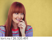 Купить «Happy redheaded female hipster looking away against yellow background», фото № 26320491, снято 25 сентября 2018 г. (c) Wavebreak Media / Фотобанк Лори