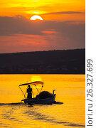 Sunset setting sun lonely boat Novigrad small coastal town in Croatia. Стоковое фото, фотограф Emil Pozar / age Fotostock / Фотобанк Лори