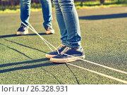 Купить «Young girls playing chinese jumping rope», фото № 26328931, снято 14 мая 2017 г. (c) Георгий Дзюра / Фотобанк Лори