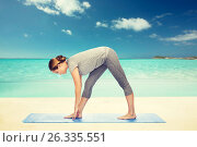Купить «woman making yoga intense stretch pose on mat», фото № 26335551, снято 13 ноября 2015 г. (c) Syda Productions / Фотобанк Лори
