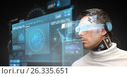 Купить «man in virtual reality glasses and microchip», фото № 26335651, снято 17 ноября 2012 г. (c) Syda Productions / Фотобанк Лори