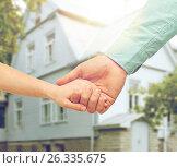 Купить «father and child holding hands over house», фото № 26335675, снято 9 апреля 2014 г. (c) Syda Productions / Фотобанк Лори