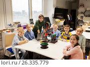 Купить «happy children with 3d printer at robotics school», фото № 26335779, снято 23 октября 2016 г. (c) Syda Productions / Фотобанк Лори