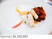 Купить «white fish with stewed eggplant garnish on plate», фото № 26335891, снято 26 февраля 2017 г. (c) Syda Productions / Фотобанк Лори