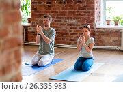 man and woman meditating at yoga studio, фото № 26335983, снято 5 марта 2017 г. (c) Syda Productions / Фотобанк Лори