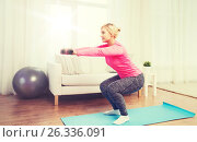 Купить «smiling woman with dumbbells exercising at home», фото № 26336091, снято 7 февраля 2016 г. (c) Syda Productions / Фотобанк Лори